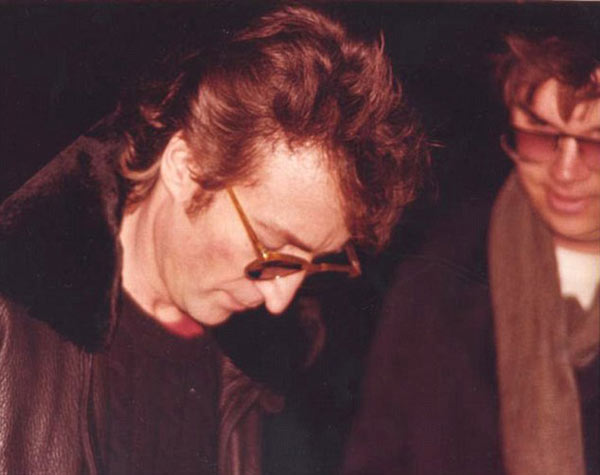 Fated meeting: John Lennon signs Mark Chapman's copy of Double Fantasy outside the Dakota Building in 1980, hours before Chapman killed him